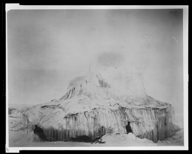 [Two men with sled in front of a large ice formation during the Lady Franklin Bay Expedition]