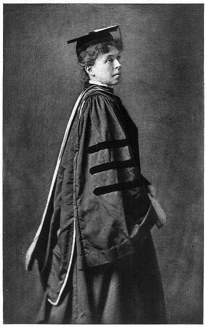 [Alice (Freeman) Palmer, 1855-1902; three-quarters length, standing, wearing academic cap and gown, facing right]