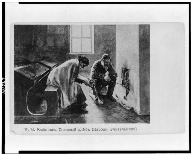 [Two teachers huddled in front of fireplace in schoolroom in Russia]