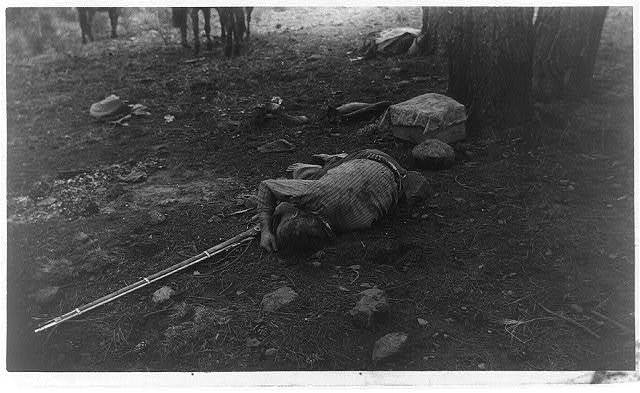[Dead man lying on ground next to rifle--U.S. Army expeditions in Central Arizona]