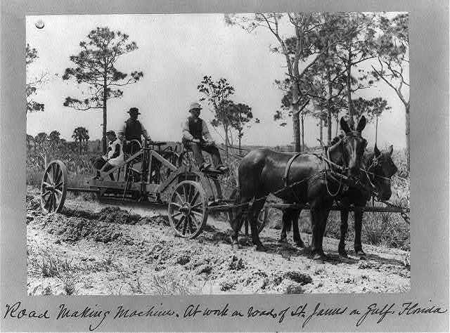 Road making machine - at work on roads of St. James on Gulf, Florida