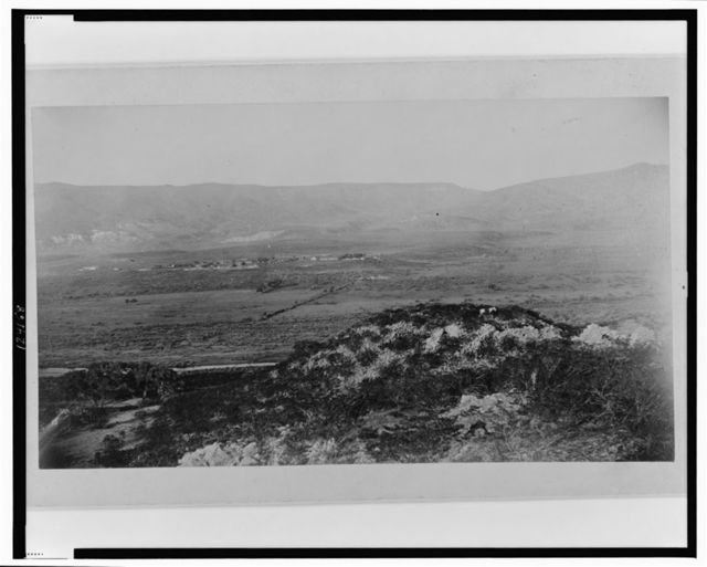 Ruins of village No. 20, from the southeast, with the Verde River and Fort Verde shown in the background