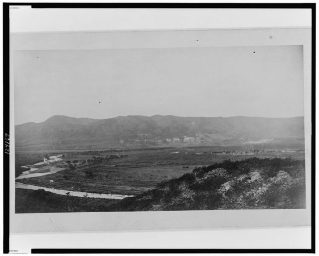 Ruins of village No. 20, south side, with the Verde River and Fort Verde shown in the distance