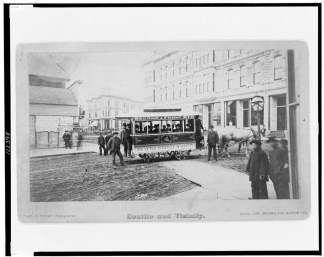 [Seattle's first street car turning from Occidental Avenue to Yesler Way] / Theo. E. Peiser, photographer.