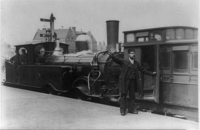 "The head guard on the South Eastern Railway, 1885--The engine is one of Richard Christopher Mansell's ""Gunboat"" 0-4-4 tanks, built for Greenwich, Woolrich and Blackheath local services"