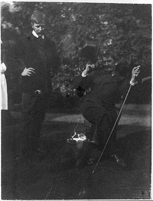 [Whistler seated with Mortimer Menpes standing. Whistler wears the much talked about coat wth cape and curly brimmed hat]