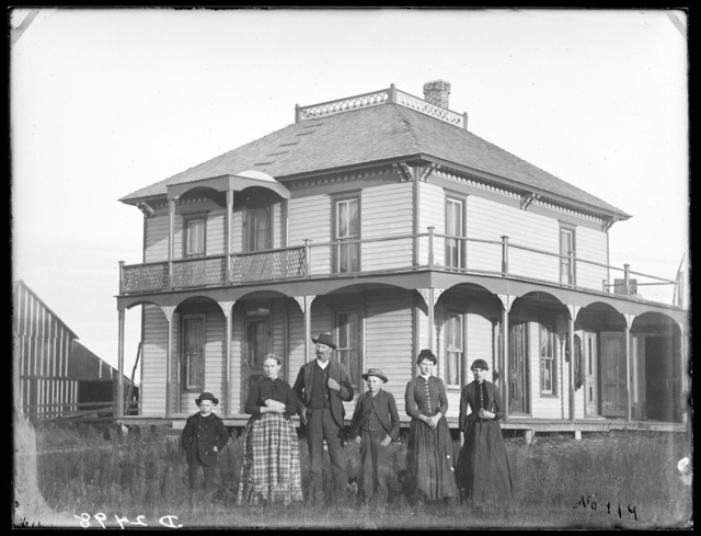 Anne (or Ame) Gandy and family in front of their home in Broken Bow, Custer County, Nebraska.