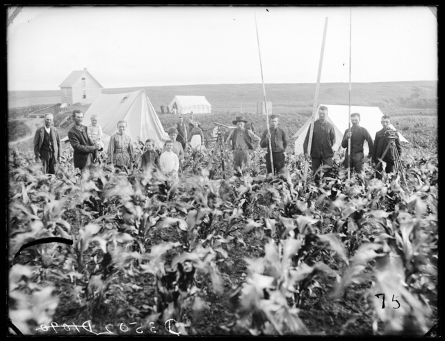 Burlington Railroad surveyors west of Sargent, Nebraska, working through a man's cornfield