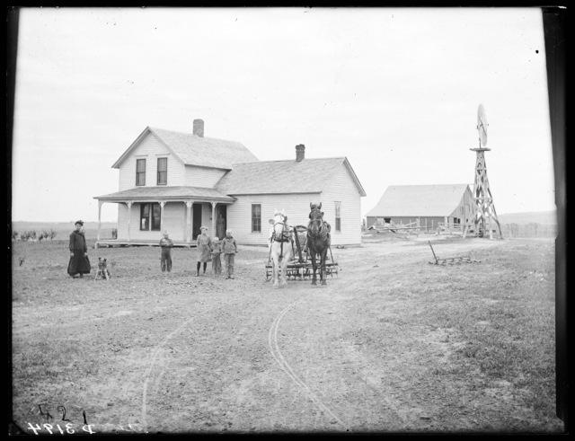 Family in front of the G.M. Farmer farmhouse near Merna, Custer County, Nebraska.