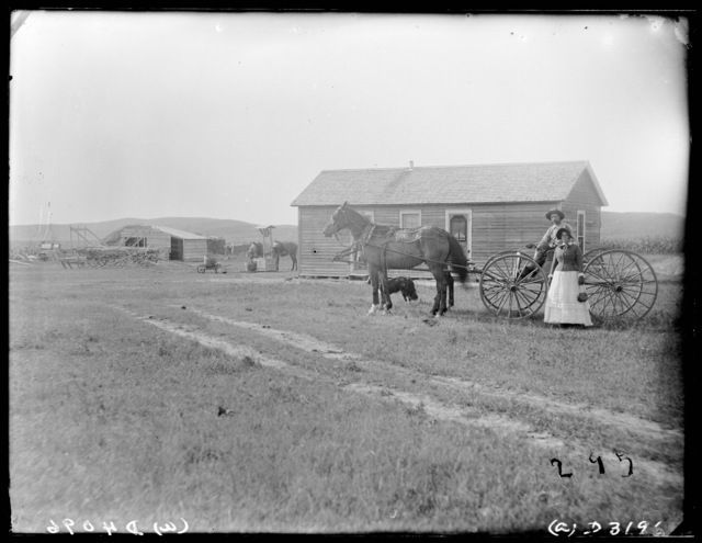 Family in front of the Gustavison house at Sargent, Custer County, Nebraska.