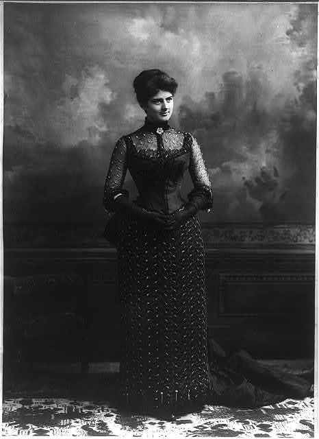 [Frances (Folsom) Cleveland, 1864-1947, full length portrait, standing, facing right; in formal gown]