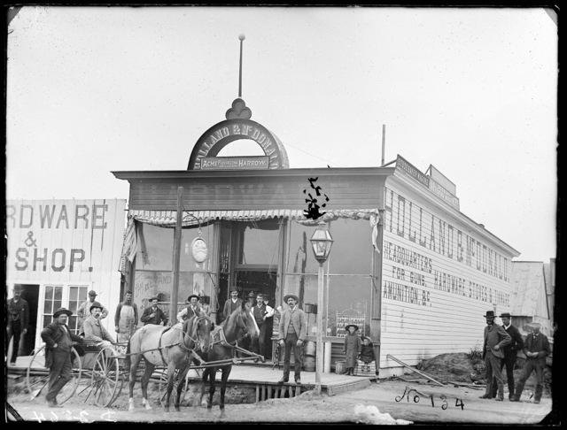 Group in front of the Holland & McDonald Hardware Store, Broken Bow, Nebraska.