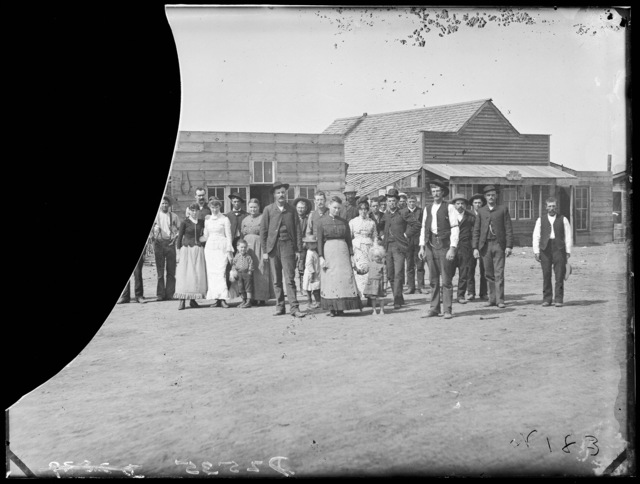 Group of people in front of the post office in Merna, Custer County, Nebraska.