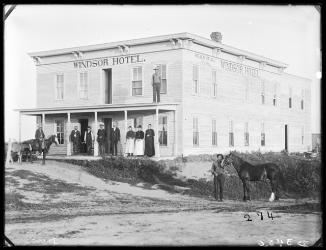 Group on porch of Windsor Hotel at Sargent, Custer County.