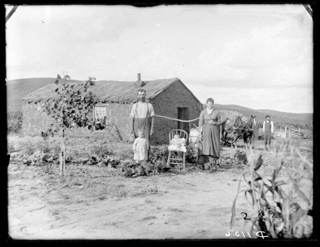 John Sewler and his young family, near Woods Park, Custer County, Nebraska.