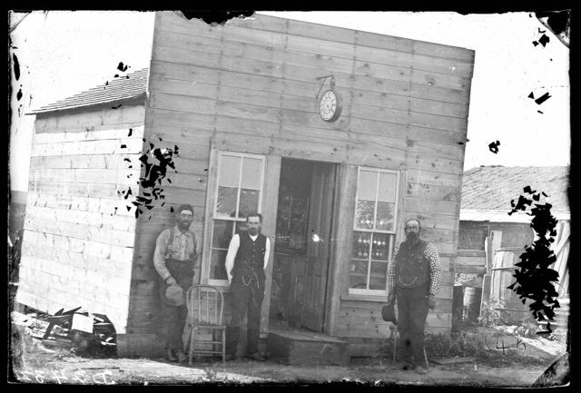 O. Godon and other men in front of his store in Merna, Custer County, Nebraska.