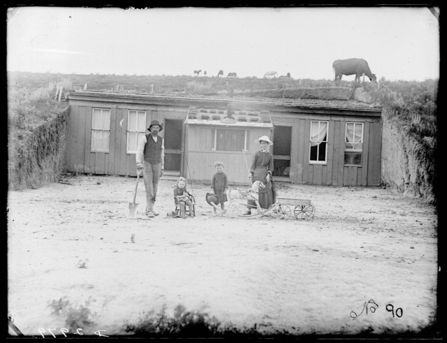 Robbins dugout, West Union, T.P. with frame front, Custer County, Nebraska.