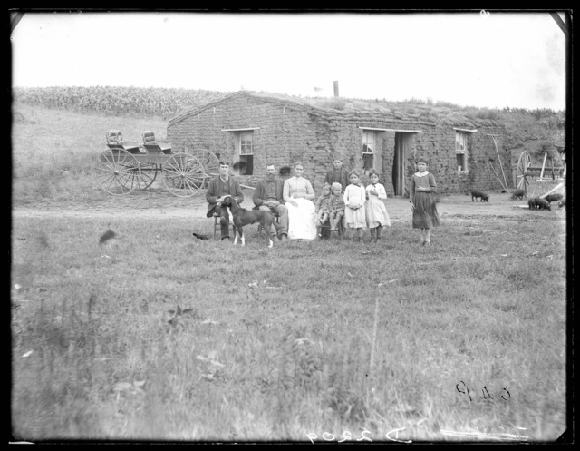 Sod house and William I. Coen family, four and one-half miles north of Berywn, Custer County, Nebraska