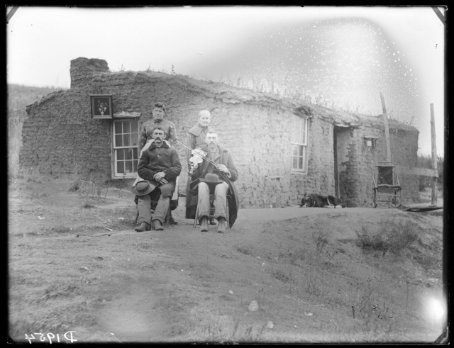 Sod school house in Custer County, Nebraska.  Mary E. Sutton, teacher