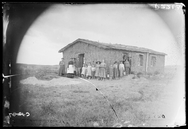 Sod school house with students and teachers, Custer County, Nebraska.