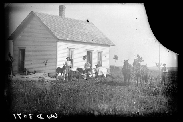 The David Garrison family in front of their house in Custer County, Nebraska,