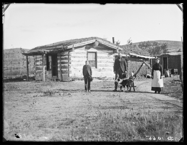 The log and sod house of Frank Cozad, 2 miles east of New Helena, Nebraska