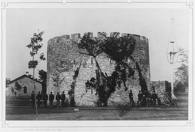 [Watch tower, Fort Snelling, Minneapolis, 11 soldiers in front]