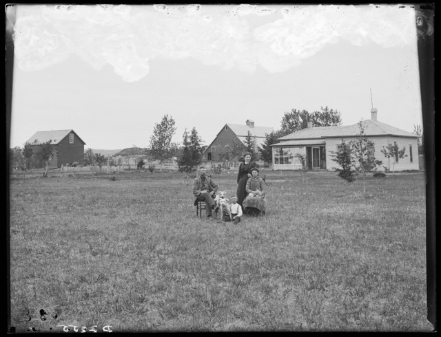 Alvin Daily family and their new farm house, Milburn, Custer County, Nebraska.