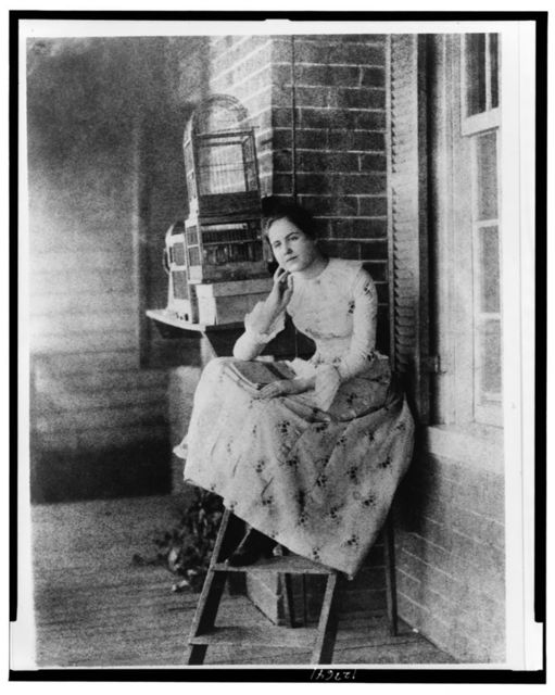 [Edith Bolling Galt Wilson, full-length portrait, seated on porch(?), facing slightly left, at age 15]
