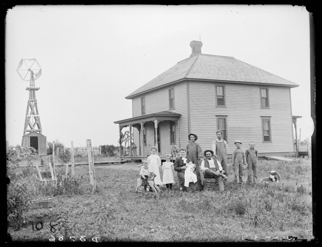Family in front of Ira Lundy's farmhouse near Cummings, Nebraska