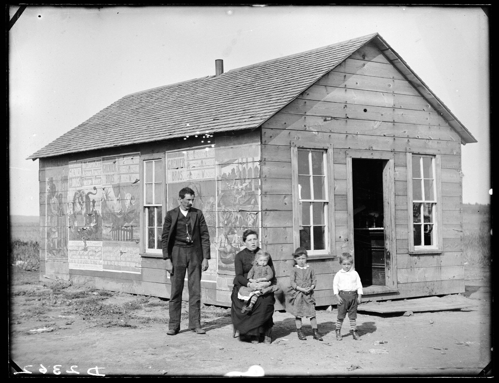 Family in front of their home in east Custer County, Nebraska, near Lee Park.