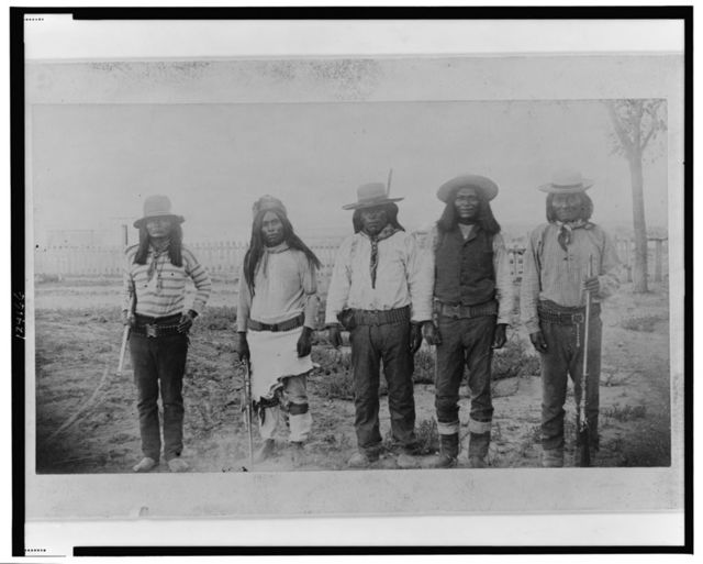 """Four Mojave Indian chiefs--The second file from the left is """"Rowdy"""", a Yuma Indian, acting as interpreter"""