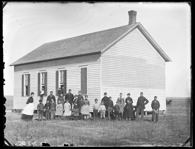 Group of students and teachers in front of a school building in West Union, Nebraska.