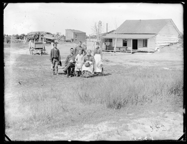 Jeff Williams and family in front of log house, West Union, Custer County, Nebraska,.
