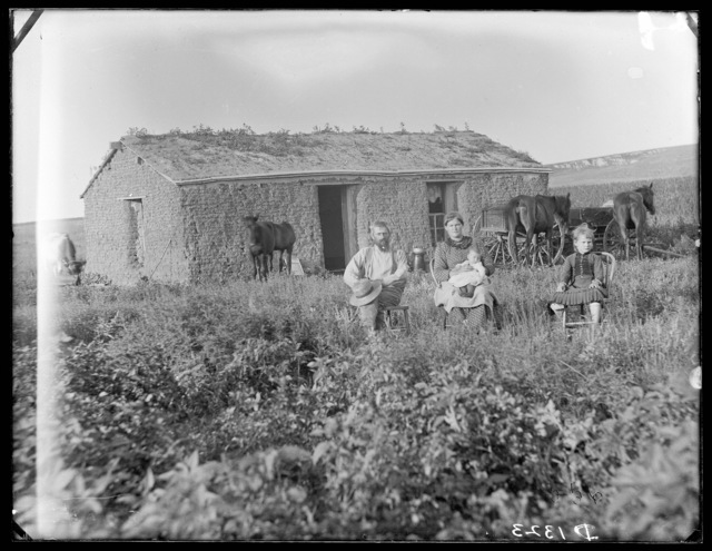 Jules Haumont family in front of their sod house, north of Broken Bow, Custer County, Nebraska.