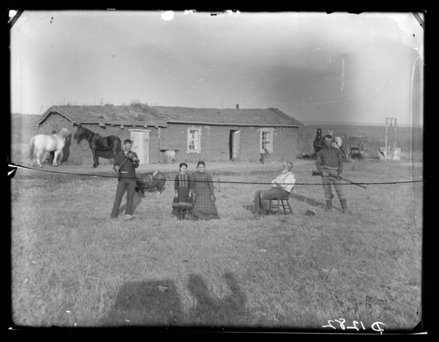 """Our Interests on the Prairie.""   A sod house in Custer County, Nebraska."