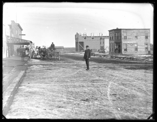 "Street scene in Broken Bow, Nebraska showing the new printing office of the ""Nebraska Statesman"" under construction"