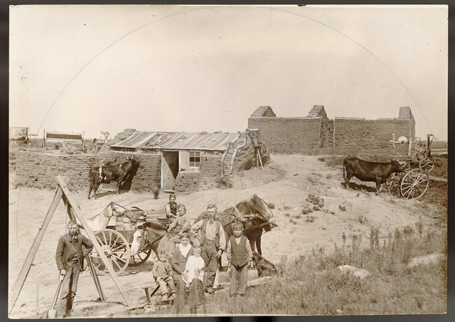 """The Old Sod House and the New."" The Jacob Graff house near West Union, Custer County, Nebraska."