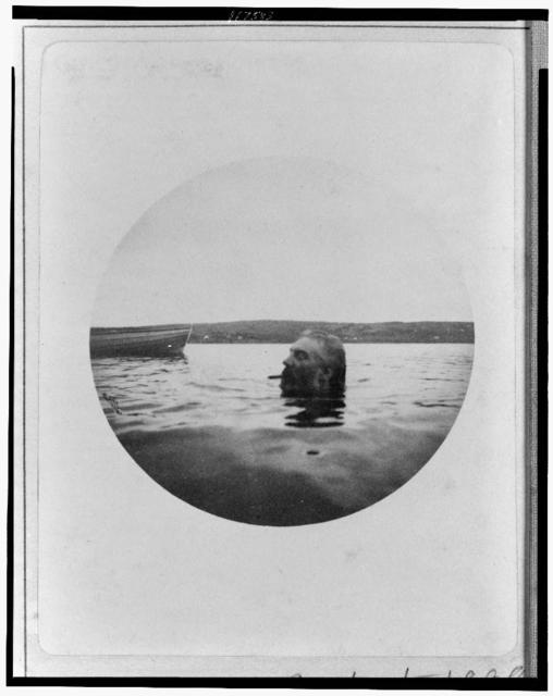 [Alexander Graham Bell swimming, his head above water, with cigar in his mouth]