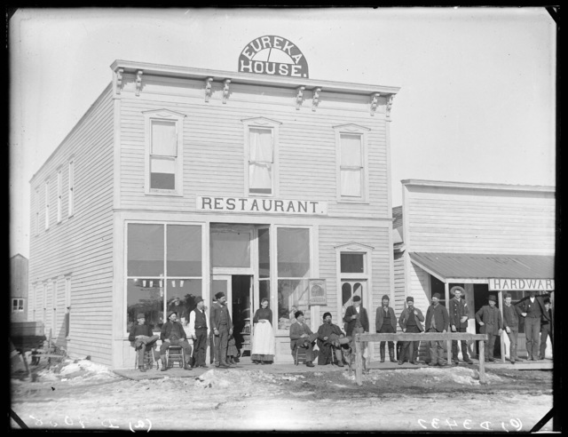 Group of people in front of the Eureka House of Sargent, Custer County, Nebraska.