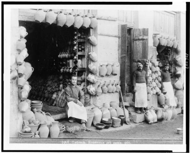 [Men with pottery in front of two stores, Tʻbilisi, Georgia]