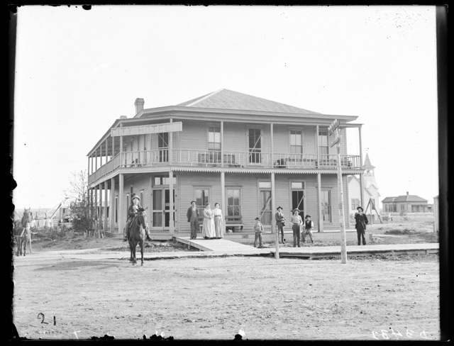 People gathered in front of the City Hotel, Sargent, Custer County, Nebraska.