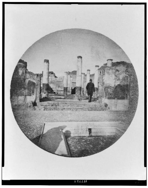 [Rear view of Alexander Graham Bell entering ruins of Pompeii]
