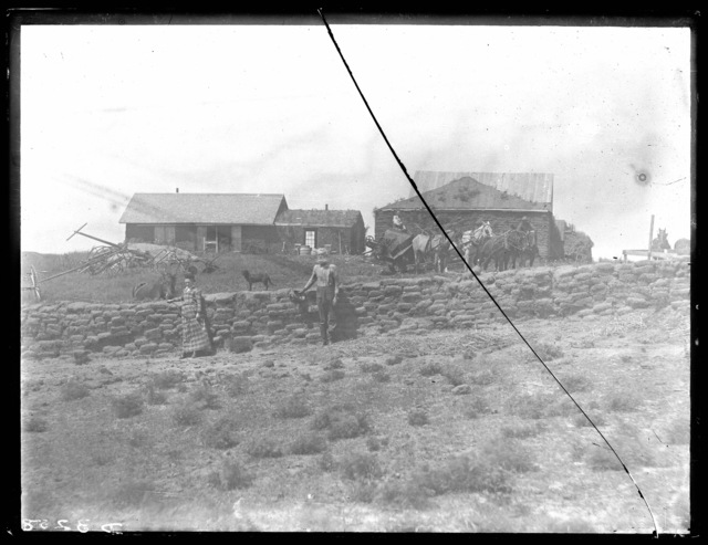 Sod house with sod fence in Custer County, Nebraska.