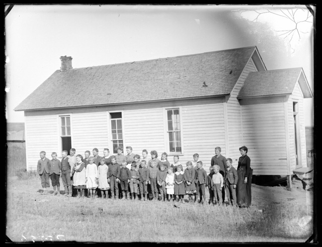 Students and their teacher in front of a country school in east Custer County, Nebraska.