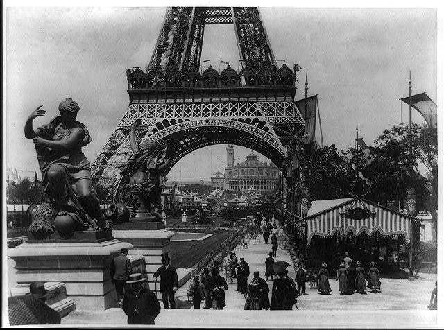 [Base of Eiffel Tower with Trocadéro Palace in background, as seen from the Fountain Coutan, Paris Exposition, 1889]