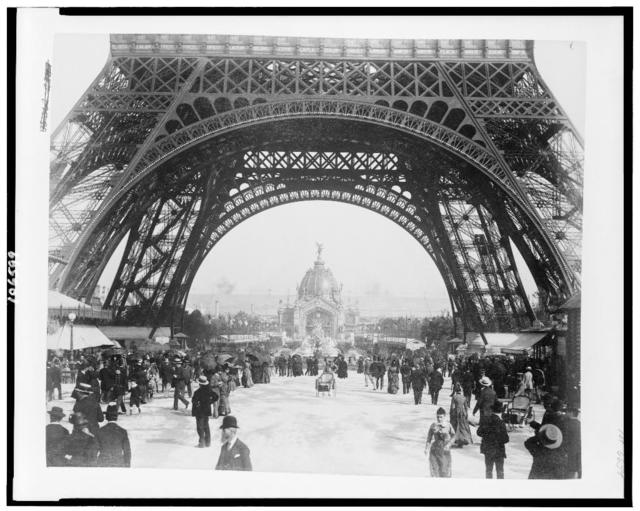[Central Dome and the Fountain Coutan seen through the base of the Eiffel Tower, with crowd on the Champ de Mars, Paris Exposition, 1889]