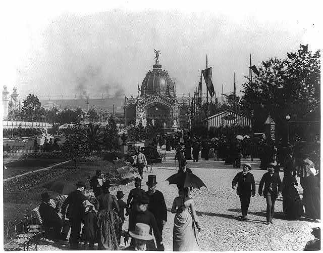 [Crowd of people along parterre beside illuminated fountains, view toward the Central Dome, Paris Exposition, 1889]