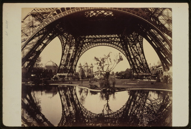 [Exhibit buildings and grounds seen through the lower part of the Eiffel Tower, Paris Exposition, 1889]