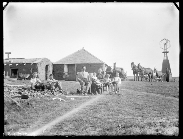 Family in front of a sod house in west Custer County, Nebraska.
